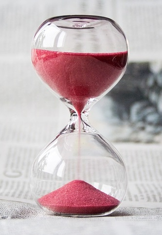 Time saved by automated documents measured by a red sand hourglass